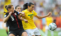 Christie Rampone (l) of team USA and Marta of team Brazil during the FIFA Women's World Cup at the FIFA Stadium in Dresden, Germany on July 10th, 2011.