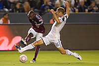 Gregg Berhalter defender of the LA Galaxy reaches to block a ball from Colorado Rapids forward Omar Cummings. The Colorado Rapids defeated the LA Galaxy 3-2 at Home Depot Center stadium in Carson, California on Saturday October 16, 2010.