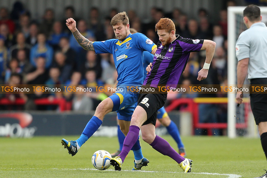 Matt Harrold of Bristol Rovers comes under pressure from Harry Pell of AFC Wimbledon - AFC Wimbledon vs Bristol Rovers - Sky Bet League Two Football at Kingsmeadow, Norbiton, London - 05/04/14 - MANDATORY CREDIT: Simon Roe/TGSPHOTO - Self billing applies where appropriate - 0845 094 6026 - contact@tgsphoto.co.uk - NO UNPAID USE