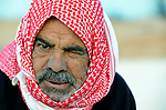 A man in the Zaatari Refugee Camp, located near Mafraq, Jordan. Opened in July, 2012, the camp holds upwards of 50,000 refugees from the civil war inside Syria. International Orthodox Christian Charities and other members of the ACT Alliance are active in the camp providing essential items and services.