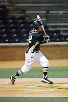 Joe Napolitano (12) of the Wake Forest Demon Deacons follows through on his swing against the Delaware Blue Hens at Wake Forest Baseball Park on February 13, 2015 in Winston-Salem, North Carolina.  The Demon Deacons defeated the Blue Hens 3-2.  (Brian Westerholt/Four Seam Images)
