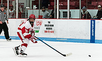 BOSTON, MA - JANUARY 04: Kristina Schuler #14 of Boston University looks to pass during a game between University of Maine and Boston University at Walter Brown Arena on January 04, 2020 in Boston, Massachusetts.