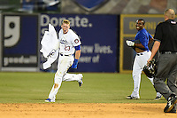 Chattanooga Lookouts outfielder Jeremy Hazelbaker (23) runs away with O'Koyea Dickson's (right) jersey after a walk off victory during a game against the Birmingham Barons on April 24, 2014 at AT&T Field in Chattanooga, Tennessee.  Chattanooga defeated Birmingham 5-4.  (Mike Janes/Four Seam Images)