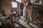 Voodoo shrine<br /> Lom&eacute;, Togo<br /> Priests tend to a fetish altar.  With a sacrifice of a chicken or goat they heal the sick, predict the future, and tell oral histories.