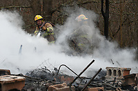 NWA Democrat-Gazette/J.T. WAMPLER Firefighters from Elkins Fire Department work Monday March 19, 2018 at 13191 Hazel Valley Road in southeast Washington County south of Elkins. Round Mountain Fire Department responded with Elkins to the call that came in at 2:52 P.M. but the house was completely destroyed when the crews arrived according to Washington County fire marshal Dennis Ledbetter.