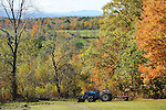 View of Farmstead with Colorful Foliage during Fall Season in Rural Alstead, New Hampshire USA