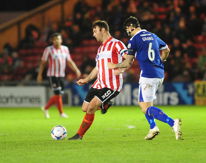 Lincoln City's Matt Rhead vies for possession with Barrow's Simon Grand<br /> <br /> Photographer Andrew Vaughan/CameraSport<br /> <br /> Football - Vanarama National League - Lincoln City v Barrow - Saturday 19th December 2015 - Sincil Bank - Lincoln<br /> <br /> &copy; CameraSport - 43 Linden Ave. Countesthorpe. Leicester. England. LE8 5PG - Tel: +44 (0) 116 277 4147 - admin@camerasport.com - www.camerasport.com