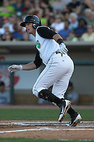 Dayton Dragons first baseman Sean Buckley #7 bats during a game against the Lake County Captains at Fifth Third Field on June 25, 2012 in Dayton, Ohio. Lake County defeated Dayton 8-3. (Brace Hemmelgarn/Four Seam Images)