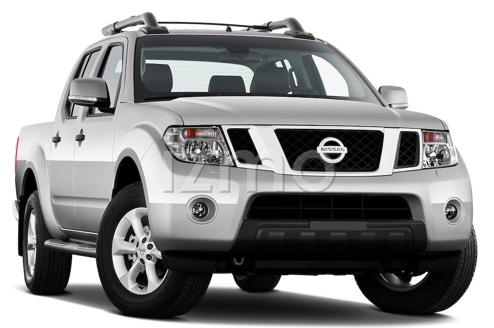 Low aggressive passenger side front three quarter view of 2010 Nissan Navara LE 4 door Pick-Up Truck .