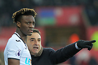 Swansea manager Carlos Carvalhal (R) speaks to Tammy Abraham of Swansea City on the touch line during the Premier League match between Swansea City and West Ham United at The Liberty Stadium, Swansea, Wales, UK. Saturday 03 March 2018