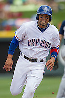 Round Rock Express designated hitter Robinson Chirinos #14 runs to third base against the New Orleans Zephyrs in the Pacific Coast League baseball game on April 21, 2013 at the Dell Diamond in Round Rock, Texas. Round Rock defeated New Orleans 7-1. (Andrew Woolley/Four Seam Images).