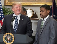 United States President Donald J. Trump makes remarks prior to signing a proclamation to honor Dr. Martin Luther King, Jr. Day in the Roosevelt Room of the White House in Washington, DC on Friday, January 12, 2018.  Looking on from right is Isaac Newton Farris, Jr., Nephew of Martin Luther King Jr.<br /> CAP/MPI/RS<br /> &copy;RS/MPI/Capital Pictures