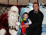 Louis Doherty Clarke and his dad David pictured with Santa at the Yurt on Laurence street as part of the Bonanza Festival. Photo: Colin Bell/pressphotos.ie
