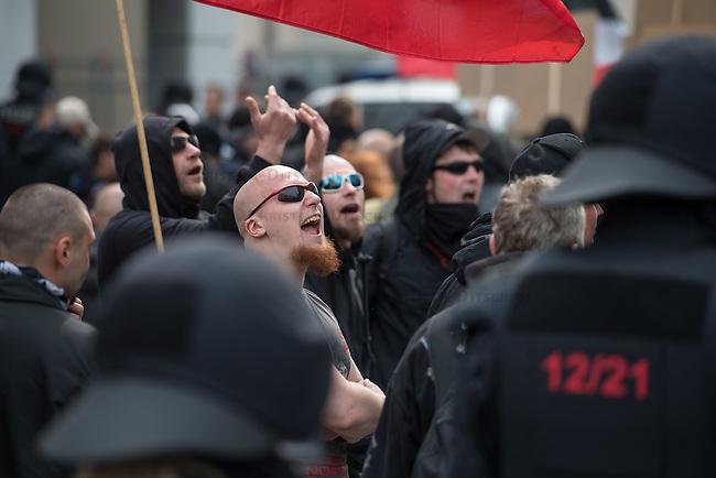 Ca. 1000 Nazis aus ganz Deutschland marschierten am Sonntag den 1. Mai 2016 im Saeschsichen Plauen auf. Die Naziorganisation 3.Weg hatte den Marsch angemeldet. Etliche Nazis waren dabei vermummt und zeigten auch den Hitlergruss, die Polizei schritt jedoch nicht ein.<br /> Nach der Haelfte der Marschroute beendeten die Nazis ihre Demonstration, da die Polizei die Marschroute verkuerzen wollte. Sie forderten die Polizei auf den Weg freizugeben. Danach griffen Aufmarschteilnehmer die Polizei an, die daraufhin Wasserwerfer, Pfefferspray, Traenengas und Schlagstoecke einsetzte. Mehrere Gruppen Nazis zogen danach durch Plauen und jagten Menschen.<br /> Nach einer Stunde bekamen die Nazis einen erneuten Aufmarsch von der Polizei genehmigt und zogen zurueck zum Bahnhof.<br /> Im Bild: Nazis beleidigen Gegendemonstranten und Buerger, die an der Marschroute standen.<br /> 1.5.2016, Plauen<br /> Copyright: Christian-Ditsch.de<br /> [Inhaltsveraendernde Manipulation des Fotos nur nach ausdruecklicher Genehmigung des Fotografen. Vereinbarungen ueber Abtretung von Persoenlichkeitsrechten/Model Release der abgebildeten Person/Personen liegen nicht vor. NO MODEL RELEASE! Nur fuer Redaktionelle Zwecke. Don't publish without copyright Christian-Ditsch.de, Veroeffentlichung nur mit Fotografennennung, sowie gegen Honorar, MwSt. und Beleg. Konto: I N G - D i B a, IBAN DE58500105175400192269, BIC INGDDEFFXXX, Kontakt: post@christian-ditsch.de<br /> Bei der Bearbeitung der Dateiinformationen darf die Urheberkennzeichnung in den EXIF- und  IPTC-Daten nicht entfernt werden, diese sind in digitalen Medien nach &sect;95c UrhG rechtlich geschuetzt. Der Urhebervermerk wird gemaess &sect;13 UrhG verlangt.]