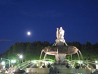 A full moon illuminates the fountain in Aix-en-Provence