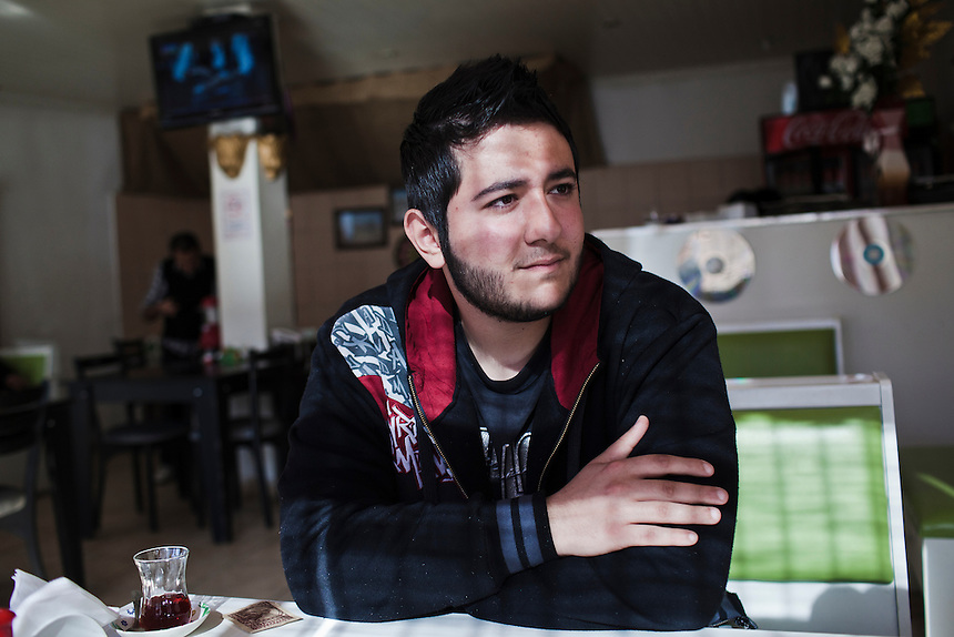 Khaled, a Syrian-Palestianian rapper, sits in a small cafe in the town of Yayladagi, Turkey, on the border with Syria, March 1, 2012. Khaled fled to Turkey in early 2012, from a refugee camp in Western Syria that his parents have inhabited since fleeing Palestine in the 1960's. Photo: Ed Giles.