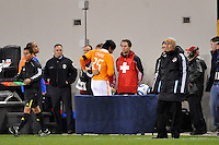 Brian Ching (25) of the Houston Dynamo heads to the locker room after being injured. The New York Red Bulls  and the Houston Dynamo played to a 1-1 tie during a Major League Soccer (MLS) match at Red Bull Arena in Harrison, NJ, on April 02, 2011.