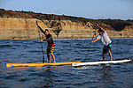 LA JOLLA, CA - FEBRUARY 28:  Watermen George Plsek and Roch Frey paddle on their stand-up paddleboards (SUP's) in front of Torrey Pines State Reserve on February 28, 2012 in La Jolla, California. (Photo by Donald Miralle)