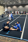 USA, Oahu, Hawaii, Jujitsu Martial Arts fighter Keith Chang and his nephew streatch before they grapple at the ICON grappling tournament in Honolulu