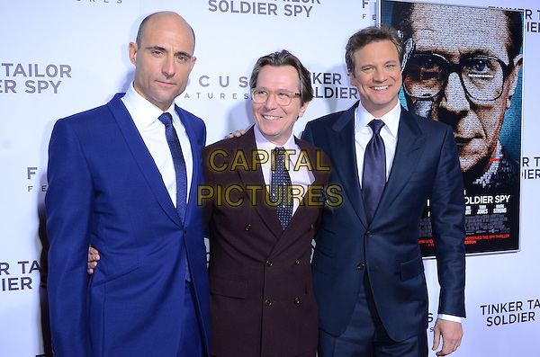 Mark Strong, Gary Oldman and Colin Firth.The premiere of Focus Features' 'Tinker, Tailor, Soldier, Spy' held at Arclight Cinema's Cinerama Dome, Los Angeles, California, USA..December 6th, 2011.half length blue white blue tie brown maroon burgundy jacket suit purple shirt glasses    .CAP/ADM/TW.©Tonya Wise/AdMedia/Capital Pictures.