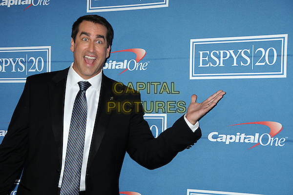Rob Riggle.2012 ESPY Awards - Press Room held at Nokia Theatre L.A. Live, Los Angeles, California, USA..July 11th, 2012.half length black suit blue tie mouth open hand.CAP/ADM/BP.©Byron Purvis/AdMedia/Capital Pictures.