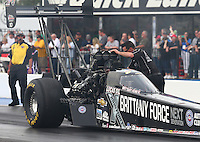 Feb 20, 2015; Chandler, AZ, USA; A crew member adjusting the fuel delivery to the engine of NHRA top fuel driver Brittany Force during qualifying for the Carquest Nationals at Wild Horse Pass Motorsports Park. Mandatory Credit: Mark J. Rebilas-