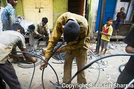 electric wire stripping at Seelampur,New Delhi,India