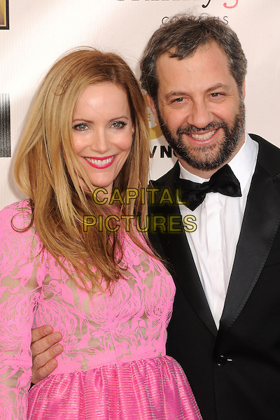 Leslie Mann, Judd Apatow.18th Annual Critics' Choice Movie Awards - Arrivals held at Barker Hangar, Santa Monica, California, USA, .10th January 2013 .half length pink gold print dress top married couple husband wife black tuxedo bow tie suit beard facial hair beauty lipstick smiling .CAP/ADM/BP.©Byron Purvis/AdMedia/Capital Pictures.