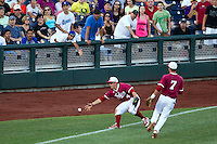 Indiana Hoosiers pinch hitter Chris Sujka (4) grabs the ball after it falls for a hit against the Oregon State Beavers during Game 9 of the 2013 Men's College World Series  on June 19, 2013 at TD Ameritrade Park in Omaha, Nebraska. The Beavers defeated the Hoosiers 1-0, eliminating Indiana from the tournament. (Andrew Woolley/Four Seam Images)