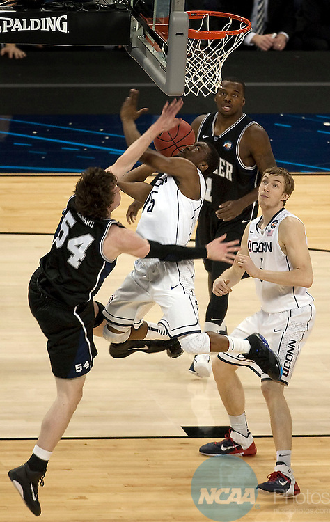 04 APRIL 2011:     Connecticut's #15, Kemba Walker, center, drives the lane against Butler's #54, Matt Howard, left, as Butler's #1, Shelvin Mack and UConn's #5, Niels Giffey look on during the first half of action in the 2011 NCAA Men's DI Basketball Championship Final Four held at Reliant Stadium in Houston, Texas on Monday, April 4, 2011. Connecticut defeated Butler 51-43. Rudy Gonzalez/ NCAA Photos