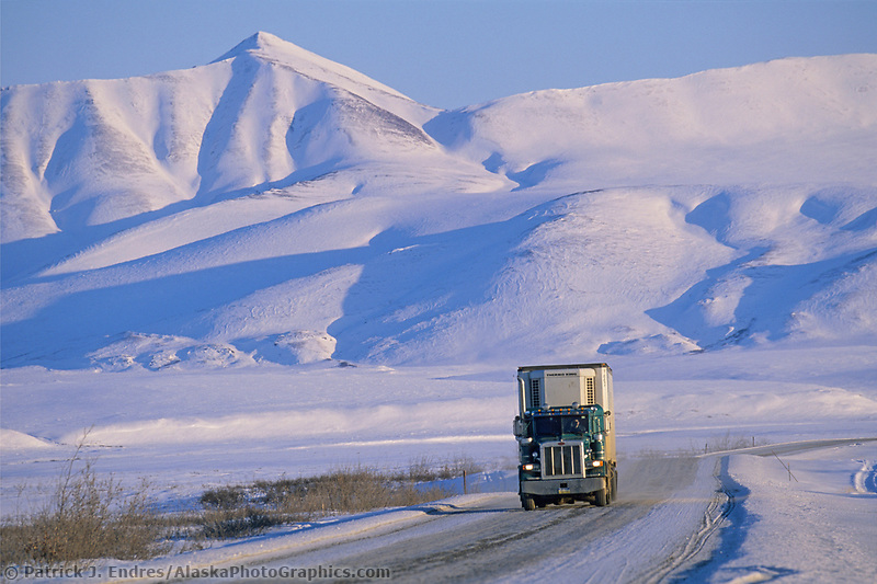 Truck on the James Dalton Highway (haul road) transports goods to Prudhoe bay, Philip Smith mountains of the Brooks Range, Arctic, Alaska.