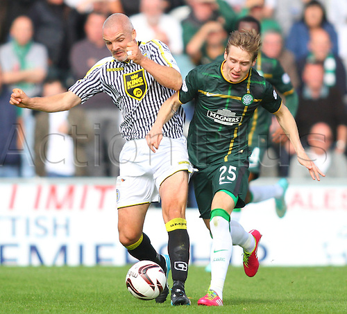 27.09.2014.  Glasgow, Scotland. Scottish Premier League. St Mirren versus Celtic. Stefan Johansen and Jim Goodwin challenge for the ball