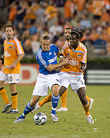 Kansas City Wizards defender Eloy Colombano (16) pushes Houston Dynamo forward Joseph Ngwenya (33) off the ball. The Houston Dynamo defeated the Kansas City Wizards 2-0 at Robertson Stadium in Houston, TX on November 10, 2007 to capture the MLS Western Conference Championship. The Houston Dynamo will take on the New England Revolution in the MLS Cup Final on November 18, 2007 at RFK Stadium in Washington D.C.