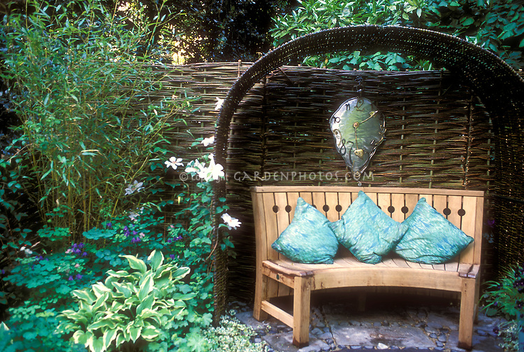 Garden bench and arbor with whimsical clock 11474
