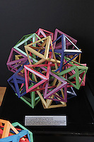 OrigamiUSA Convention 2015 Exhibition. Five Interlocking Irregular Hyperboloidal Dodecaugmented Cuboctahedra 120 Units designed and folded by Byriah Loper, KY.
