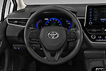 Car pictures of steering wheel view of a 2020 Toyota Corolla-Hybrid LE 4 Door Sedan Steering Wheel