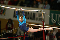 May 01, 2004; Amsterdam, Netherlands; ALINA KOZICH of Ukraine performs on uneven bars to win<br />