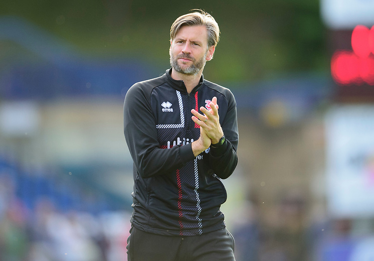 Lincoln City's assistant manager Nicky Cowley applauds the fans at the final whistle<br /> <br /> Photographer Andrew Vaughan/CameraSport<br /> <br /> The EFL Sky Bet League One - Wycombe Wanderers v Lincoln City - Saturday 7th September 2019 - Adams Park - Wycombe<br /> <br /> World Copyright © 2019 CameraSport. All rights reserved. 43 Linden Ave. Countesthorpe. Leicester. England. LE8 5PG - Tel: +44 (0) 116 277 4147 - admin@camerasport.com - www.camerasport.com