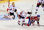 11 November 2008:  Montreal Canadiens' center and Team Captain Saku Koivu from Finland (11) is checked by Ottawa Senators' defenseman Anton Volchenkov from Russia (24) in front of goaltender Alex Auld during the third period at the Bell Centre in Montreal, Quebec, Canada. The Canadiens defeated the visiting Senators 4-0. ***Editorial Sales Only***..Mandatory Photo Credit: Ed Wolfstein Photo *** Editorial Sales through Icon Sports Media *** www.iconsportsmedia.com