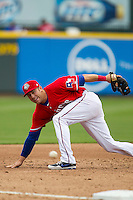 Round Rock Express third baseman Mike Olt #20 lunges for a ball hit down the line against the Omaha Storm Chasers in the Pacific Coast League baseball game on April 7, 2013 at the Dell Diamond in Round Rock, Texas. Omaha beat Round Rock 5-2, handing the Express their first loss of the season. (Andrew Woolley/Four Seam Images).