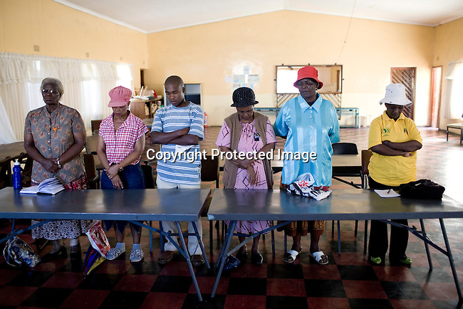 JOHANNESBURG, SOUTH AFRICA - APRIL 14: Victims of Apartheid connected to Khulumani prays during a meeting on April 14 2010, in the Methodist Church in the Zola section section of Soweto, South Africa. Khulumanie is involved in the Daimler complaint brought forward by victims of Apartheid. The plaintiffs argue that Daimler sold vehicles to the old South African government. The meeting was to plan action at the upcoming soccer World Cup in June .(Photo by Per-Anders Pettersson/Agentur Focus For Spiegel Magazine)