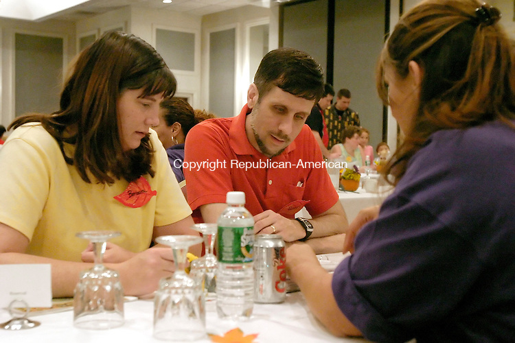 WATERBURY, CT - 22 September 2005 -092205JS03--Barbara and Russell Christopher of Danbury talk with Department of Children and Families social worker Denise Lopez during the DCF's fall adoption gala Thursday at the Grand Hotel in Waterbury.    --Jim Shannon / Republican-American  --Grand Hotel; Waterbury; Denise Lopez, Barbara Christopher, Russell Christopher, Danbury are CQ