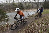 NWA Democrat-Gazette/FLIP PUTTHOFF <br /> THIRTY YEARS OF MOUNTAIN BIKING<br /> Riders pedal the Fossil Flats Trail along Lee Creek on Saturday April 7 at the 30th annual Ozark Mountain Bike Festival at Devil's Den State Park. Saturday's events included guided group rides, bicycle games for kids and an evening dinner for riders. Group rides continue today along the Fossil Flats Trail at Campground A.
