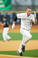 Mac Williamson #7 of the Wake Forest Demon Deacons hustles down the third base line against to score a run against the Charlotte 49ers at Gene Hooks Field on March 22, 2011 in Winston-Salem, North Carolina.  Photo by Brian Westerholt / Four Seam Images