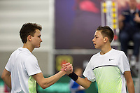 March 8, 2015, Netherlands, Rotterdam, TC Victoria, NOJK, Amadatis Admiraal wins boys 16 years and is congretulated by runner up Wisse Jonker (L)<br /> Photo: Tennisimages/Henk Koster