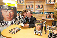 NO REPRO FEE.8/10/2011. Eason, Ireland's leading retailer of books, stationery, magazines and lots more, hosted a book signing by Jockey, Paul Carberry.  Pictured at Eason, O'Connell Street, Dublin is fan Mary Musgrave from Kerry and Paul Carberry who signed copies of his new autobiography One Hell of a Ride. Follow Eason on Twitter - @easons For further information, please contact: Aoife McDonald WHPR 087 4100777 . Picture James Horan/Collins Photos
