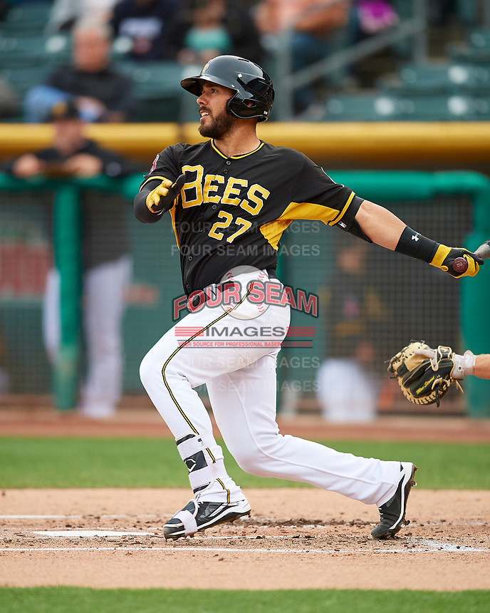 Tony Sanchez (27) of the Salt Lake Bees follows through on his swing against the Fresno Grizzlies during the Pacific Coast League game at Smith's Ballpark on April 17, 2017 in Salt Lake City, Utah. The Bees defeated the Grizzlies 6-2. (Stephen Smith/Four Seam Images)