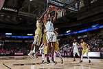 Doral Moore (4) of the Wake Forest Demon Deacons grabs an offensive rebound in front of three Georgia Tech Yellow Jackets defenders during second half action at the LJVM Coliseum on February 14, 2018 in Winston-Salem, North Carolina.  The Demon Deacons defeated the Yellow Jackets 79-62.  (Brian Westerholt/Sports On Film)
