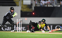 Wicketkeeper Tim Seifert attempts to stump David Warner. New Zealand Black Caps v Australia.Tri-Series International Twenty20 cricket final. Eden Park, Auckland, New Zealand. Wednesday 21 February 2018. © Copyright Photo: Andrew Cornaga / www.Photosport.nz