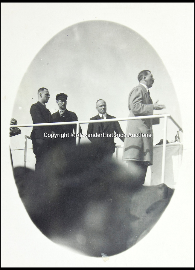 BNPS.co.uk (01202 558833)<br /> Pic: AlexanderHistoricalAuctions/BNPS<br /> <br /> Hitler giving a speech.<br /> <br /> Chilling early photographs of the Nazi party which show Adolf Hitler basking in the adulation of his fanatical supporters and Jews being persecuted have been unearthed.<br /> <br /> The disturbing images from an SS officer's photo album date from 1931 to 1935 so they cover the period of the Nazis' rise to power and the first two years of the dictatorship.<br /> <br /> The album was recovered by US Army officer Philips Parks Ramsey after the war but his family have now decided to put it up for auction and it is tipped to sell for £1,500 ($2,000).